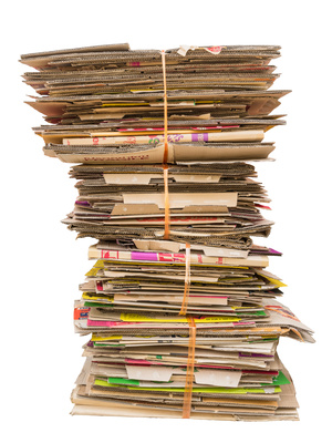 pile of old cardboard boxes for recycling on white background